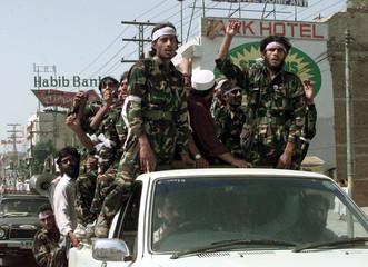 "Pakistani Moslem guerrillas from Al-Badr Mujahideen chant ""Allah-o-Akbar"" (God is great) as they car.."