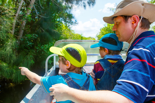 Two little kids boys and father making air boat tour in Everglades Park