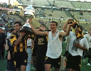 BENGOECHEA, RODRIGUEZ AND CAFU CELEBRATE PENAROL VICTORY.