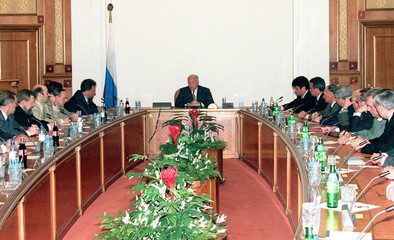 Newly appointed acting Prime Minister Viktor Chernomyrdin (C) heads the cabinet meeting in a governm..