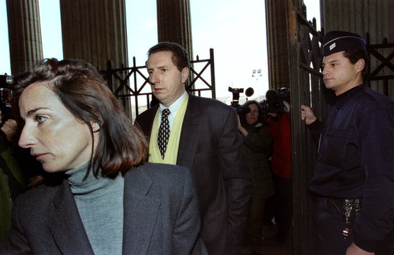 French businessman Pierre Botton (C ) arrives at the courthouse behind his lawyer Frederique Pons (L..