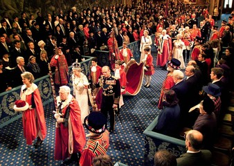 QUEEN ELIZABETH HEADS A PROCESSION INTO THE HOUSE OF LORDS IN LONDON.