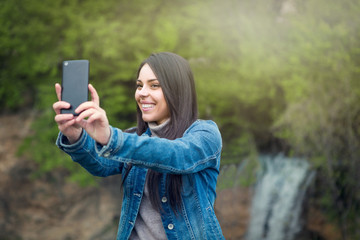 Young woman taking selfie by cellphone