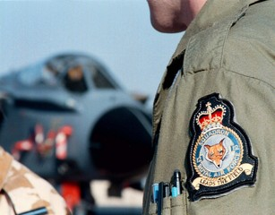 A Royal Airforce Tornado fighter pilot, on December 20, shows the Fox insignia on his uniform which ..