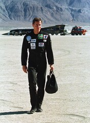 Andy Green, driver of ThrustSSC, the British jet car in the background that will attempt to break th..