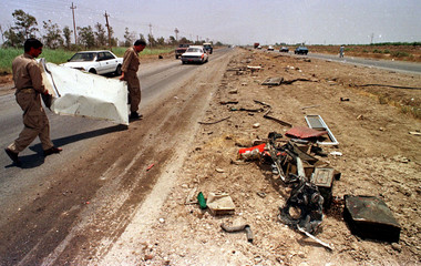 IRANIAN MUJAHIDEEN CLEAR UP AFTER BOMB BLAST IN BAGHDAD.