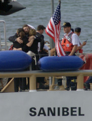 Participants in the burial at sea of John F. Kennedy Jr., his wife Carolyn Bessette Kennedy and her ..