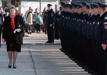 Bosnian Serb President Biljana Plavsic reviews policemen in a Police Academy marking the patron sain..