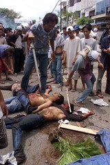 INDONESIAN MOSLEMS WALK OVER THE BODIES OF AMBONESE IN JAKARTA.