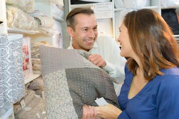 Couple choosing cushions