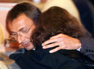 Andreas Freudemann (L) hugs his lawyer Christina Roth during the judgement delivery on a Bavarian ab..