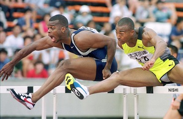 BRITISH COLIN JACKSON AND AMERICAN LARRY WADE COMPETE IN MEN'S 110M HURDLES IN TOKYO.