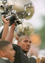 CENTRAL FLORIDA'S CULPEPPER HOLDS UP HELMET.