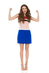 Happy Woman In High Heels With Arms Outstretched