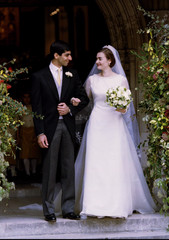 Newly wed Bride Laura Palumbo stands with her husband Neel Tikkoo on the steps of St Margaret's chur..