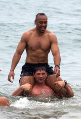 New Zeland's rugby star Johan Lomu (C) takes a break in the Rugby World Cup,taking a bath in the sea..