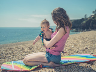 Woman with baby on beach