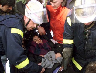 Fire officers carry an injured Kurdish protestor away from the Israeli consulate in Berlin February ..