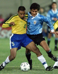 EMERSON FIGHTS WITH URUGUAYAN COHELO IN COPA AMERICA FINAL MATCH.