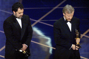 Producers James Cameron (R) and Jon Landau pause for a moment's silence for victims of the shipwreck..