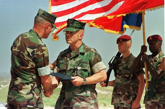US GENERAL WILHELM CONGRATULATES USSPTGP OUTGOING COMMANDER COL MORRIS.