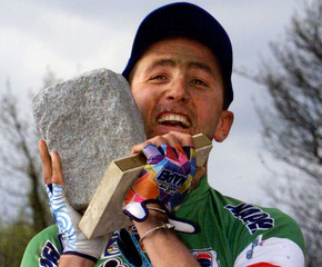 Italian cyclist Andrea Tafi  kisses his cobble stone trophy after winning of the 97th edition of Par..