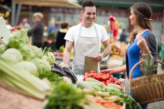 woman shopping vegetable at street market.