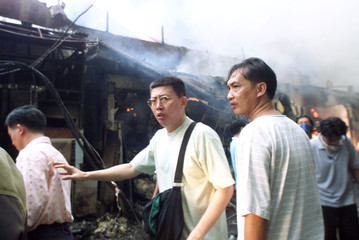 INDONESIAN ETHNIC CHINESE WITH THEIR SHOPS BURNING IN JAKARTA'S CHINATOWN.