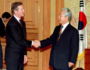 South Korean President Kim Young-sam (R) greets William Cohen, the U.S Secretary of Defence at the P..