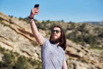 Man taking selfie photo on the mountains
