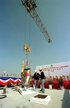 Workers prepare the 'topping out' ceremony for Superterminal One, to be the world's largest air carg..