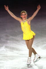 Tara Lipinski of the US performs her short skating programme during an exhibition at the Champions S..