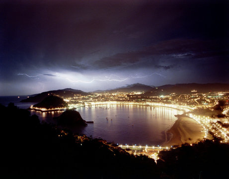 Bolts of lightning streak across the sky over San Sebastian's famous Concha beach early June 2. Spai..