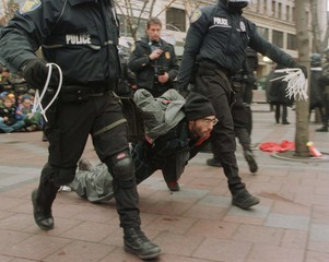 PROTESTOR CARRIED AFTER BEING ARRESTED NEAR WTO.