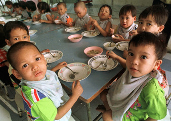 YOUNG AIDS PATIENTS SHARE A RARE HAPPY MOMENT DURING LUNCH AT A PHYATHAI BABIES' HOME FOUNDATION ...