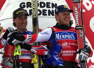 AUSTRIANS SCHIFFERER AND MAIER CELEBRATES ON PODIUM OF MEN SKI WORLD CUP DOWNHILL RACE IN VAL GARDENA.