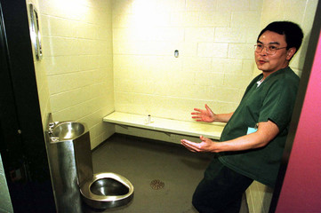 Jailed Hong Kong tobacco industry executive Jerry Lui shows a reporter the interior of a cell at the..