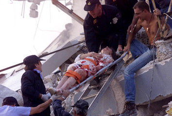 WOUNDED WOMAN RECOVERED FROM COLLAPSED BUILDING IN ATHENS.