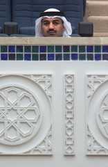 A KUWAITI SITS AT THE BALCONY OF THE KUWAIT'S PARLIAMENT.
