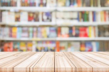 Empty wooden table top with Blur bookshelves in bookstore background.
