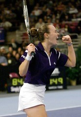 HINGIS CELEBRATES WIN OVER VENUS WILLIAMS AT CHASE CHAMPIONSHIPS.