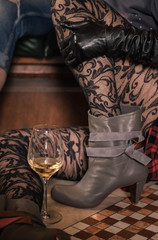 Fashion lace garter tights woman drinking wine in the pub