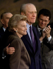 Former President Gerald R. Ford and Mrs. Betty Ford acknowledge applause after they both received th..