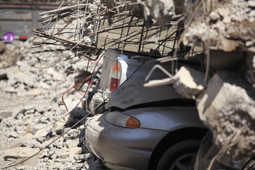 Cars under the rubble for an earthquake in Chile