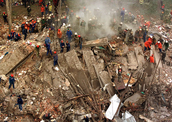 RESCUE WORKERS CLEAN RUBBLE AFTER BLAST IN MOSCOW.