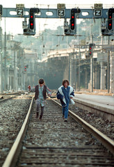 Two children play on the empty tracks at Nice's station ,December 3. Labour unions have threatened t..