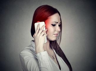 Upset sad woman talking on mobile phone. Cellular mobile radiation concept