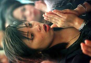 A VIETNAMESE WOMAN PRAYS AT A TEMPLE DEDICATED TO A NATIONAL HERO IN HANOI.