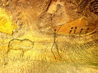 Buffalo hunting. Paint of human hunting on sandstone wall, prehistoric picture. Black carbon abstract