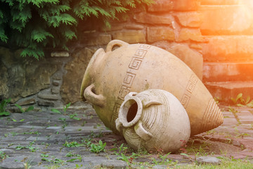 Decorative amphora in the garden in sunlights